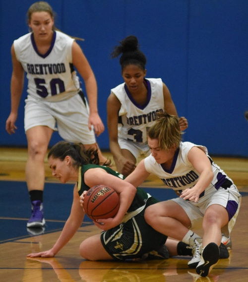 In this photo and the one below, Abby Harper knocks the ball loose from a Kennedy player and Nija Price grabs it.