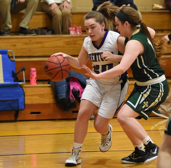 Abby Harper drives to the basket against JFK.