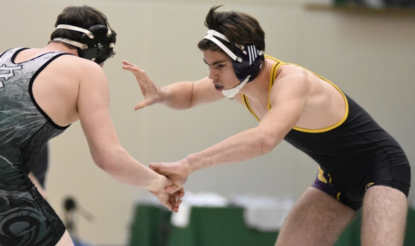 Justin Shipley tries to control the hands of Brian Mickle of New Madrid County at district.