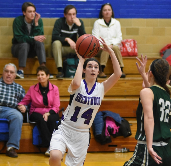 Above and below, Amanda Ingersoll drives the baseline for a layup.