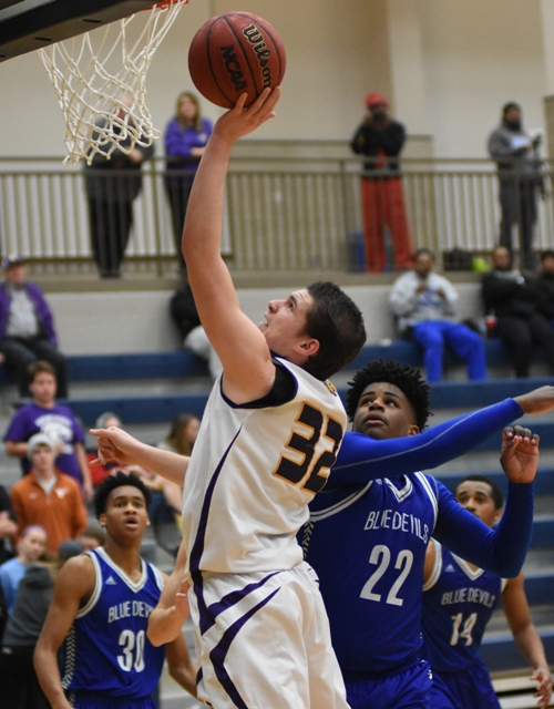 Skylar Sappington gets past MRH's Kyle Morris and banks in a layup.
