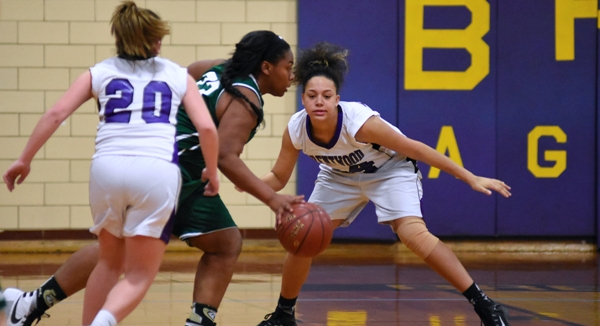 Imani Gordon (right) and Abby Harper guard a Bayless player.
