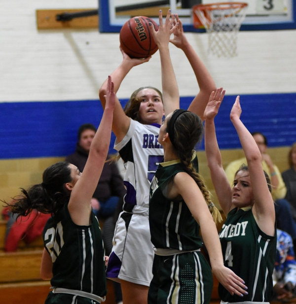 Sophia Rivera rises above the crowd to launch a shot.