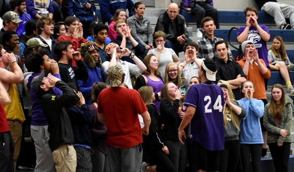 """The Brentwood student cheering section cheers a play. Said senior forward Charles Jones, """"The best part of this game was the atmosphere. It was a beautiful atmosphere, with the fans chanting at each other. That's an awesome feeling."""""""