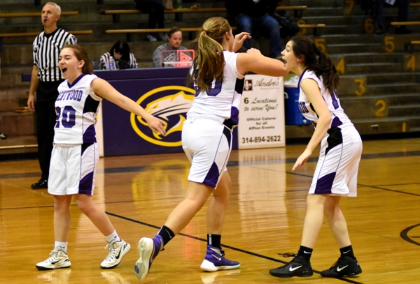 Abby Harper (left) and Amanda Ingersoll (right) react to Sophia Rivera making a free throw to beat Windsor with 00:04.4 remaining in the game. Rivera runs back to play defense but the Owls ran out of time to launch a final shot.