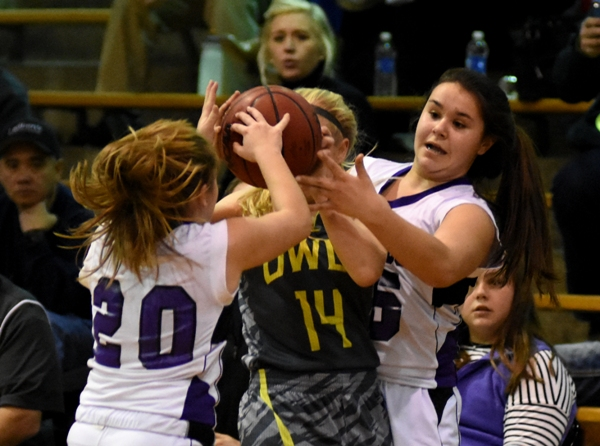 Maggie Callihan (right) and Abby Harper force a turnover from Windsor's Jill Jones.