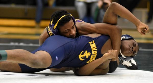 Narvell Jordan works toward a pin of Cleveland's Nashoba Moore.