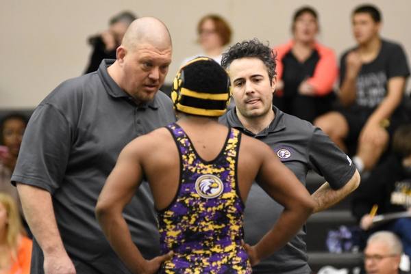 Brentwood head coach Roy Hughes (left) and assistant coach Mic Boshans consult with Gary Silerio during a break in his district match with Dillon Liefer of Lutheran St. Charles.