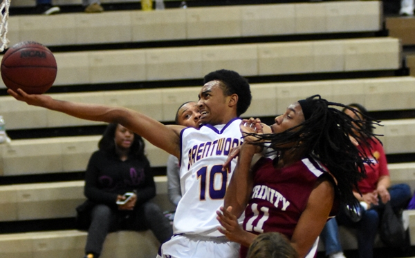 Charles Jones glides past Trinity's Torrence Triplett on the way to the net.