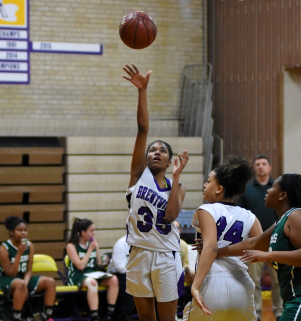 Shielded by Imani Gordon, Nija Price fires a three-point attempt against Bayless.