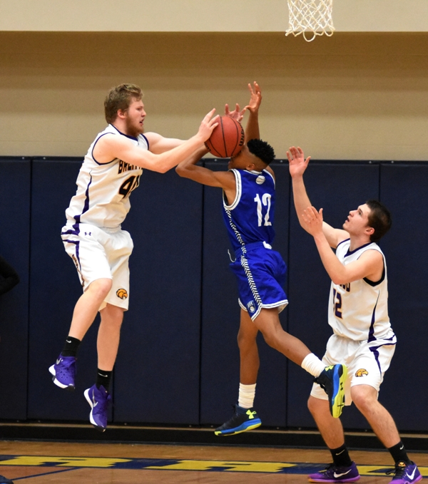 Jordan McGehee swipes a rebound from Maplewood's Joseph Jones.