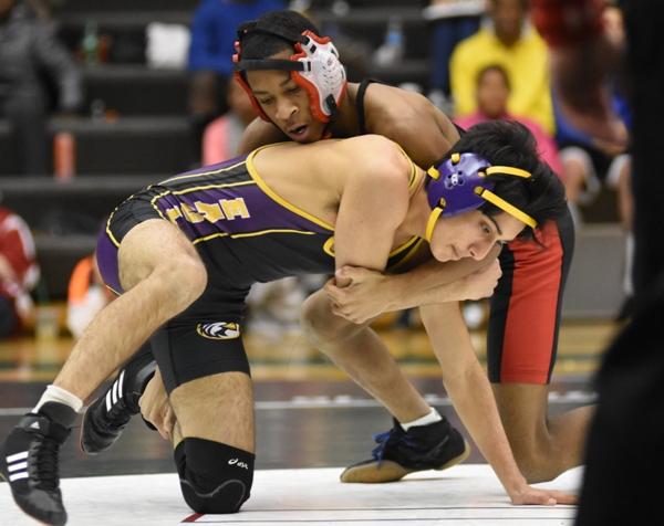 Neal Bhattacharya wrestles Lift for Life's Julian Jones.