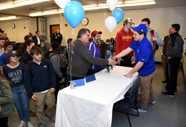 Brentwood art teacher Mike Rempel congratulates Jacob Clay at the high school on Feb. 4. (Photo by Steve Bowman)