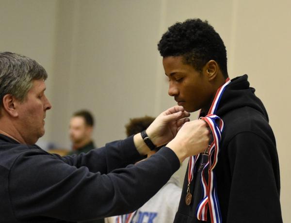Narvell Jordan receives his third-place medal.