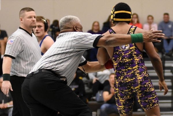 Gary Silerio (right) reacts angrily to being hit in the face with an elbow by Dillon Liefer of Lutheran St. Charles. Referee Silerio won 11-3 but