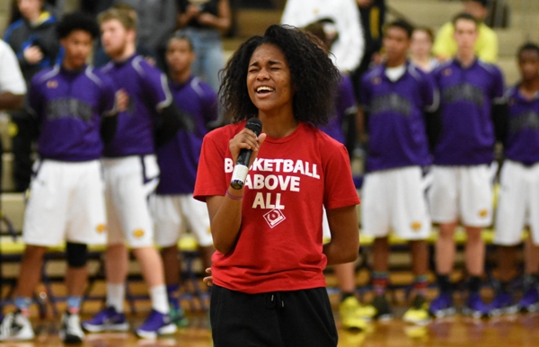 With the Brentwood basketball team behind her, sophomore Nija Price sings the National Anthem before the Trinity game last week.