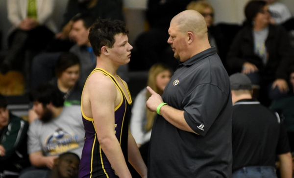 Coach Roy Hughes consoles Joe Dreyer after the senior was eliminated from the district tournament.