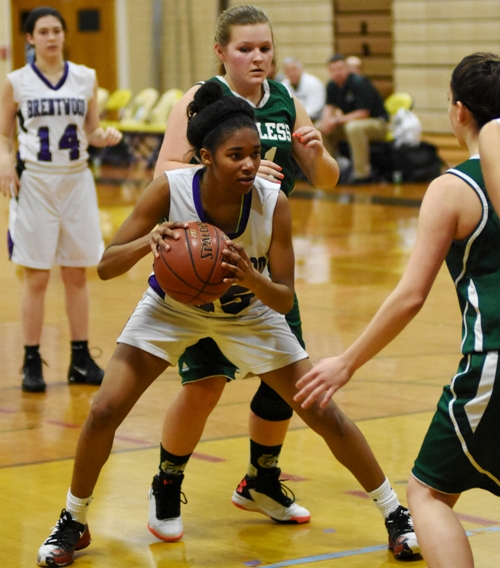 Nija Price fakes before going to the hoop.