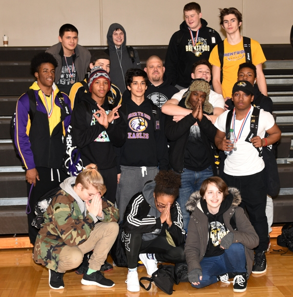 Brentwood wrestlers and the team's assistants can finally relax after winning third place at the district tournament.