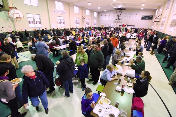 The gym at the St. Mary Magdalen Catholic School fills up for the God's Cod Fish Fry on Friday evening. (All photos by Steve Bowman)