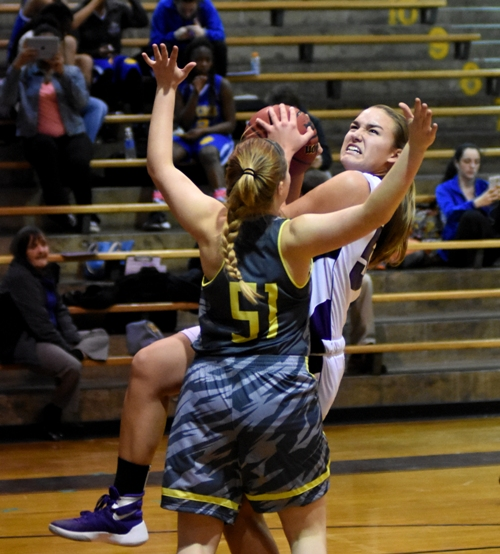 In this photo and the two below it, Sophia Rivera goes in for a layup against Windsor's Jill Jones.