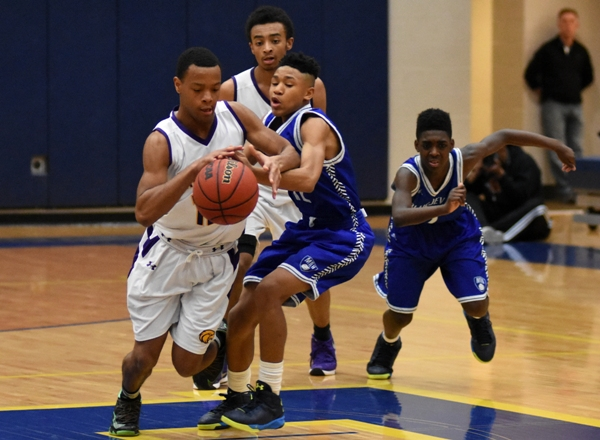 Above and below, Justice Harris steals the ball and scores a layup in the final minutes against MRH.