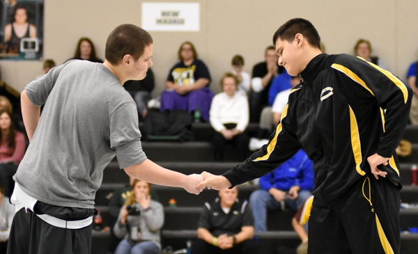 Donovan Obando shakes hands with his opponent in the medal round, Dillan Williams of Lutheran St. Charles. Obando went on to pin Williams for the third-place medal.
