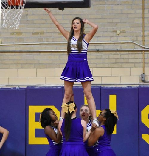 BHS cheerleader Sydney Moreno gets ready to jump . . .