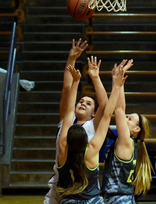 Maggie Callihan releases a shot inside against Windsor.