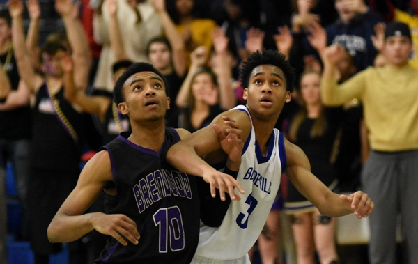Charles Jones (left) fights for position after a free throw is released on Jan. 28 in Maplewood. The teams play again in the district playoffs on Feb. 22 at John Burroughs. (All photos by Steve Bowman)