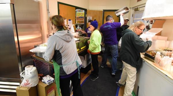 Volunteers process orders in the back.