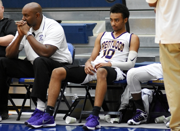 """Charles Jones takes a seat after fouling out against MRH. After leading BHS in scoring for two years, his high school career was over. He later said, """"It's been a blast here. I love it here. I love the people."""""""