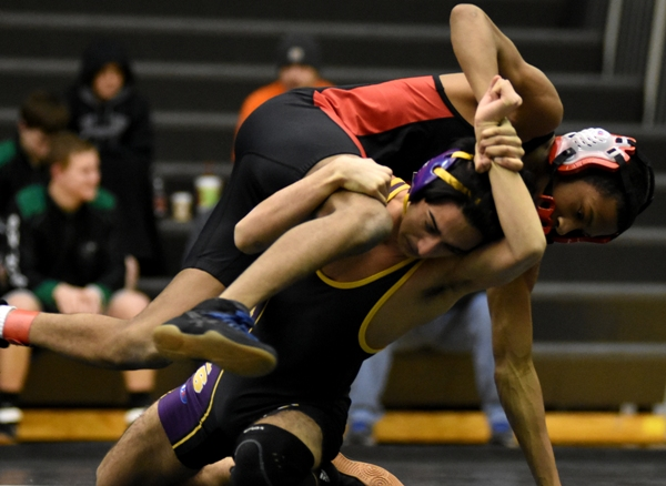 Neal Bhattacharya wrestles Julian Jones of Lift for Life, who won with a pin.