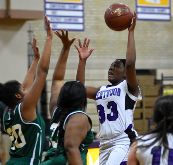 Marshelle Franklin shoots over two Bayless players.