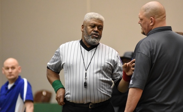 Ronald Carr (middle) speaks with Brentwood coach Roy Hughes after Gary Silerio's match with Dillon Liefer of Lutheran St. Charles. Carr is a BHS graduate and former state gold medalist in wrestling.