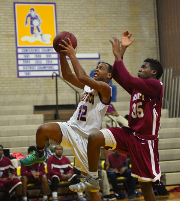 Justice Harris gets ahead of Trinity's Maurice Willis for a layup.