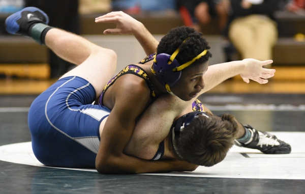 In this photo and the one below, Narvell Jordan is close to pinning Noah Ostler of Principia at the district meet.