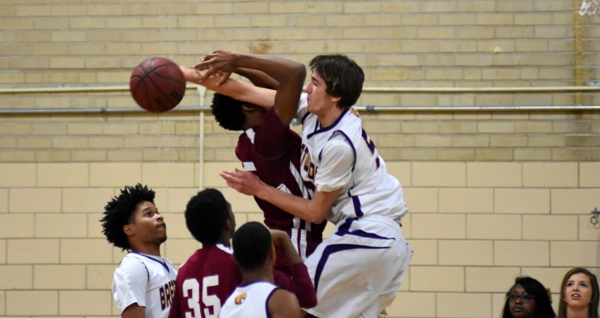 Brentwood's Jacob Menne blocks a shot by Trinity's Jim Smith last week at Brentwood High School.