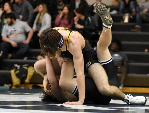 Justin Shipley completes an unconventional pin of Orchard Farm's Ayden Hynes at the district tournament.