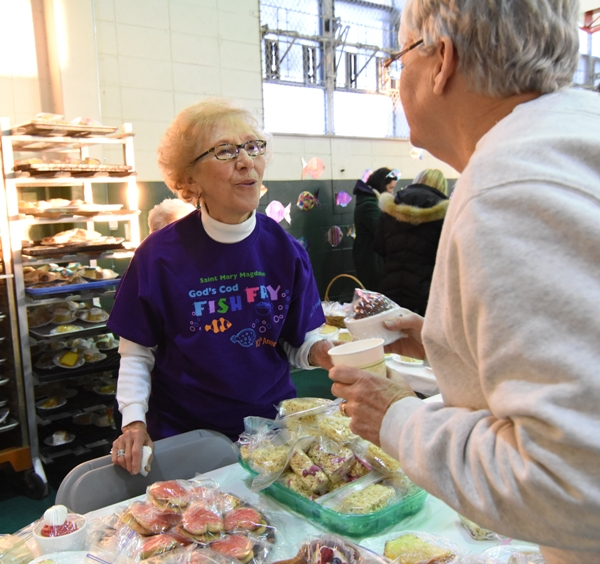 Sister Paulette Gladis speaks with a friend at the dessert station.