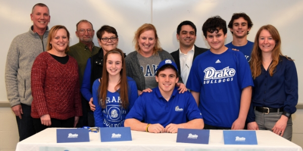 Jacob Clay didn't lack support from family at his letter-of-intent signing ceremony Feb. 4 at Brentwood High School. Among the crowd that filled a lecture room were (from left): his uncle and aunt, Tim and Pam McGrath; his grandparents, Bob and Judy Featherston; his sister, Kathleen Clay; his mother, Beth Clay; Jacob Clay; his father, Marty Clay; his brothers, John and Joe Clay; and Marty Clay's fiancée, Jennifer Keith. (Photo by Steve Bowman)
