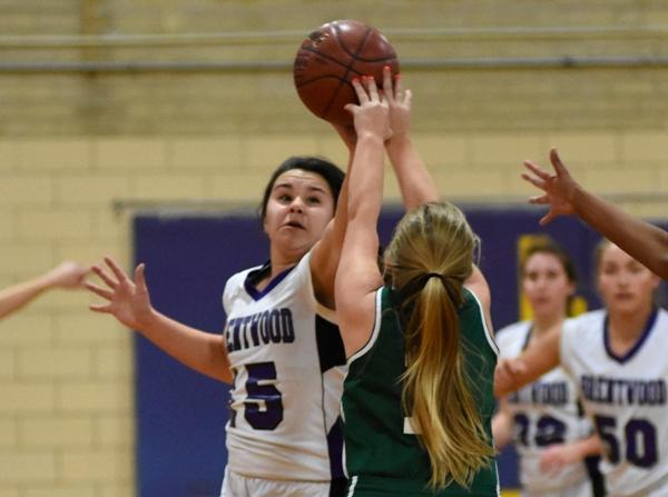 Maggie Callihan blocks a Bayless player's shot.