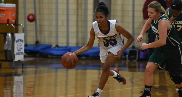Nija Price keeps the pace fast against Bayless. (All photos by Steve Bowman)