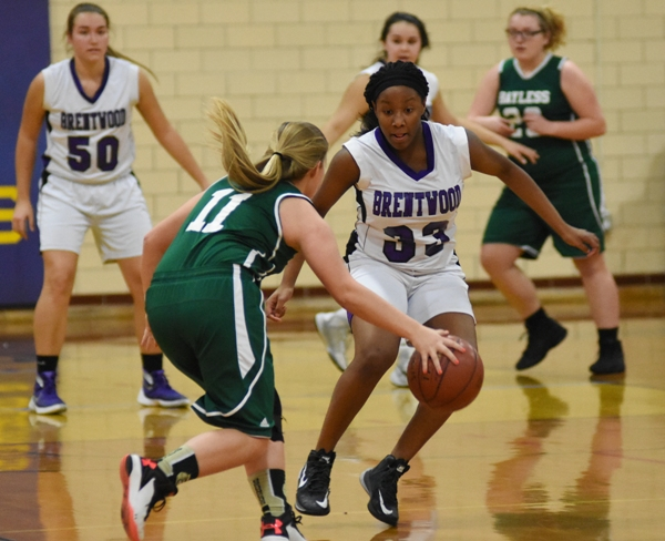 In this photo and the one below, Marshelle Franklin steals the ball from Jill Jones of Bayless.