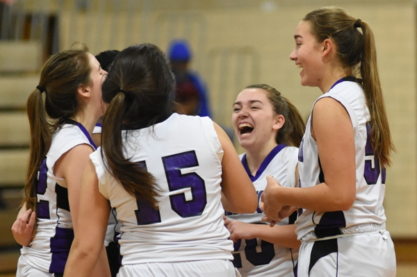 Abby Harper laughs at a comment by a teammate in the final huddle before the tipoff against Bayless.