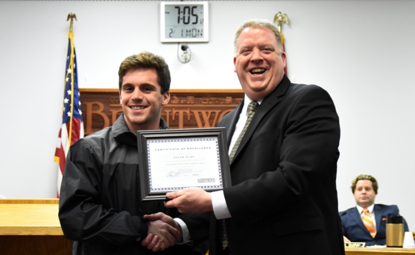 Brentwood Mayor Chris Thornton hands Jacob Clay a city proclamation honoring the 2016 senior football players who led the team to a record of 10-1. (Photo by Steve Bowman)