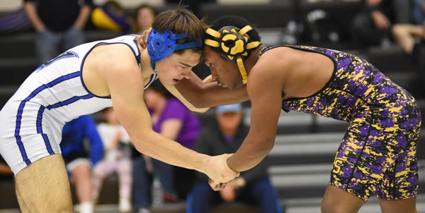 Brentwood's Gary Silerio (right) and MRH's Matt Green wrestle for the championship of the 145-pound weight class at the district tournament on Feb. 13 at Whitfield. Green won by two points and both went on to the state meet.