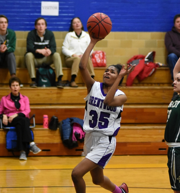 Above and below, Nija Price finds an open slot to the basket and plays tight defense on Kennedy's Jill Jones.