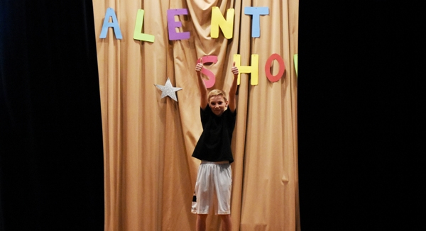 Jackson Devers gives a final wave as the curtain closes.