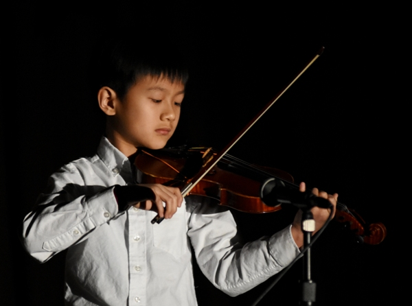 """Second grader Alex Tung plays Bach's """"Bourree."""""""